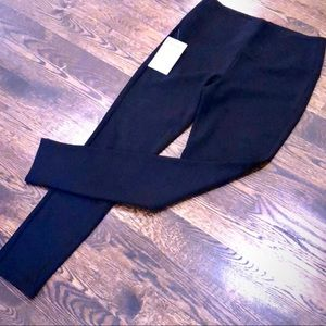 Bebe black leggings /pants with zip at the back